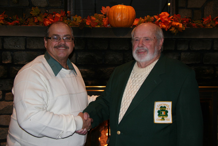 Marvin Hill, 2018 Woods Award Recipient, is congratulated by Chicopee St. Patrick's Parade Committee President Edward Kenfield.